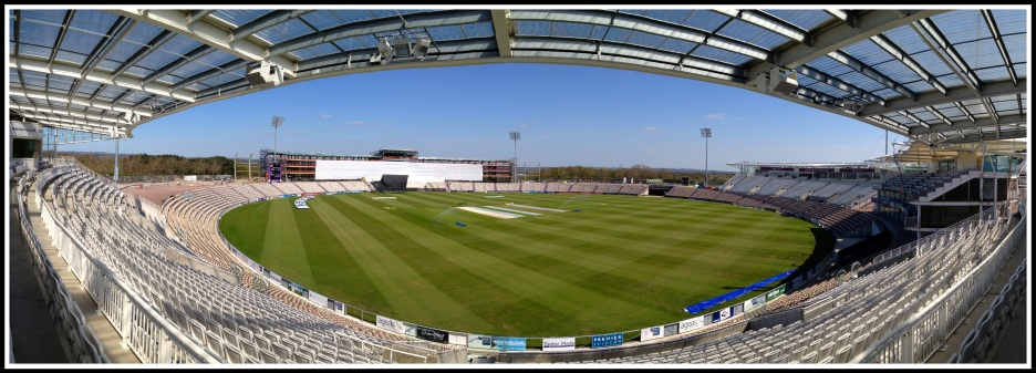 a panoramic photo taken from the seats in the cricket ground creating an oval panorama
