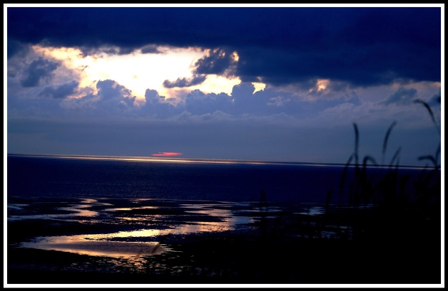 A sunset shot taken on the beach with really dark blues & purples