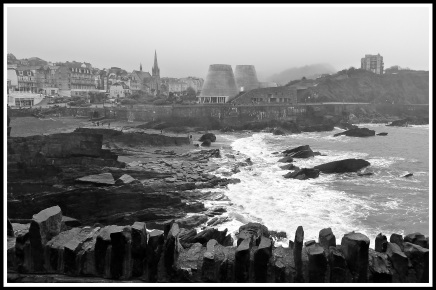 Photograph taken in a huge storm with my iPhone 4s camera. (I wouldn't get my Nikon camera out of it's bag as the weather was too bad). I've applied a grayscale effect to bring out how I felt on the day (very wet, cold and shivery). A great memory of the English southern coast on New Years Day.