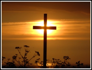 The sun is directly behind a large centred cross, and the sun is located beautifully on the intersection of the cross