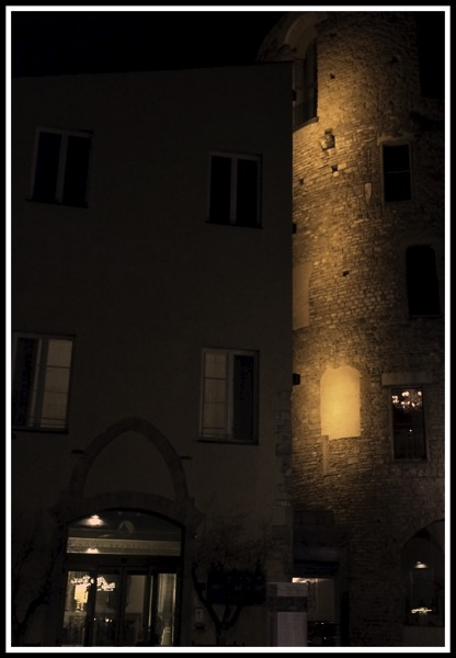 A sepia effect of hotel Brunelleschi at night with the old tower glowing out in the dark