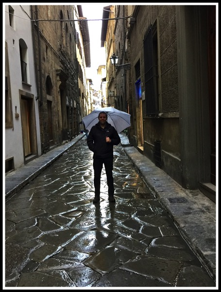 Me with umbrella in narrow streets