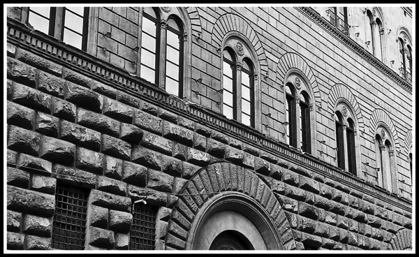 A black and white photo of the amazing brick work of the Palazzo Medici Riccardi 1