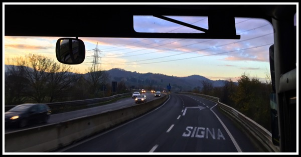 A photo of the beautiful hills taken from our seat on the bus from pisa to florence. Also Siena is written on the road.