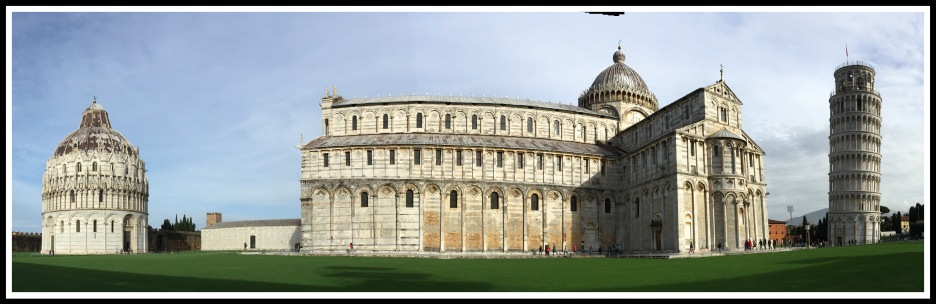 A panoramic photo with the Pisa Baptistry on the left, Cathedral in the centre and the leaning tower on the right