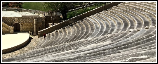 Masses of circular steps fill the image from the Roman-styled 5,000-seat amphitheater