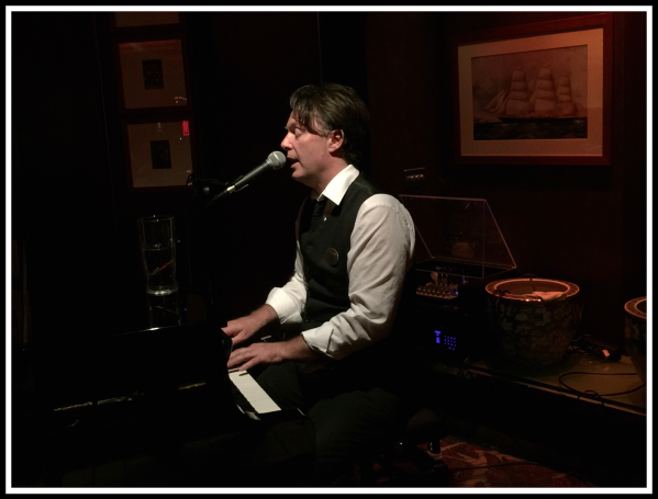 Alan Davidson playing piano and singing in Delo bar