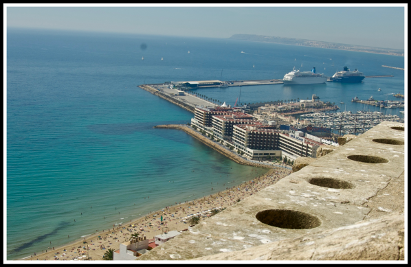 A view looking out from the top of the castle down onto the coastline of Alicante