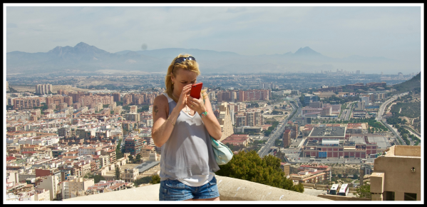 Sarah looking at her phone preparing for a panorama at the top of the castle
