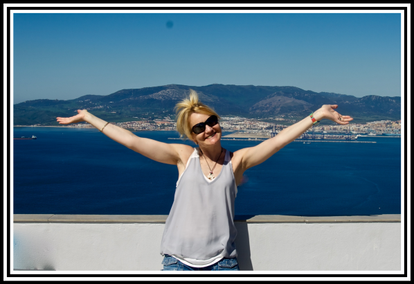 Sarah on top of Gibraltar rock waving her arms in the air and welcome to Gibraltar