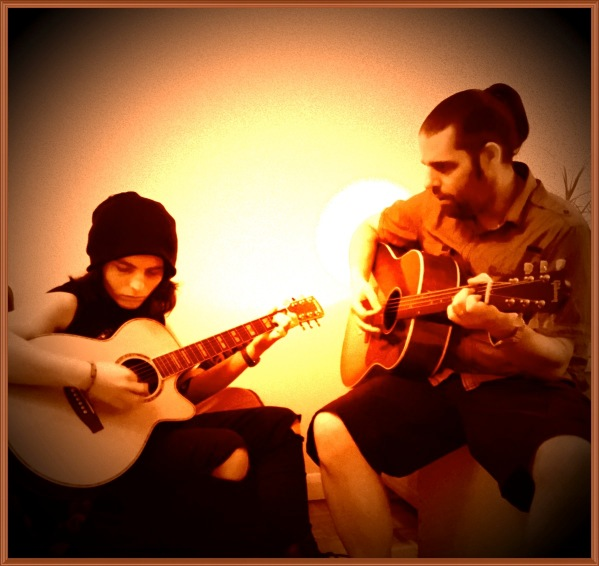 Me(on the right) playing guitar with my brother in law(on the left)