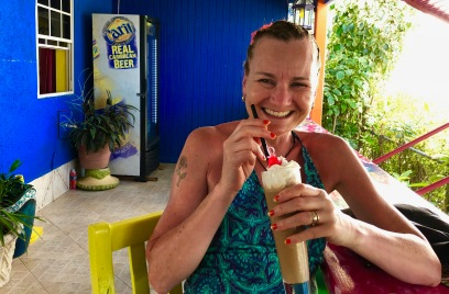 Sarah drinking a sugar free iced coffee in Sharkey's on the Gap in Barbados, April 2018