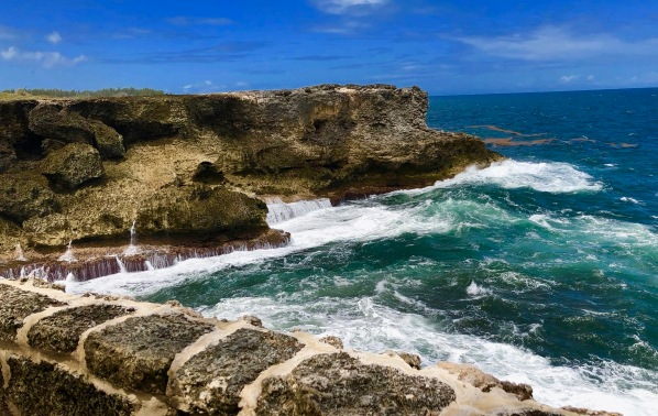 Waves crashing against the rocky coastline at North Point, Barbados
