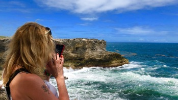 Sarah taking a photo at North Point, Barbados April 2018